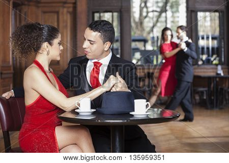 Young Couple Dating While Man And Woman Performing Tango
