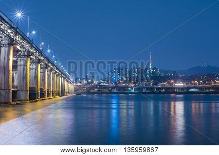 Banpo bridge in Seoul cityscape at night