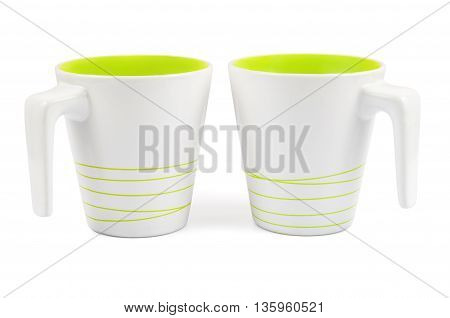 Pair of white mugs with green stripes isolated on white background with clipping path