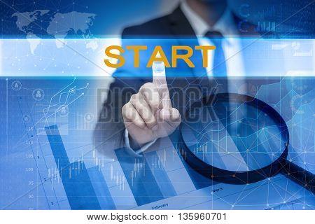 Businessman hand touching START button on virtual screen