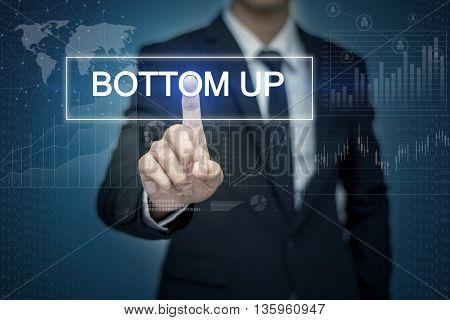 Businessman hand touching BOTTOM UP button on virtual screen