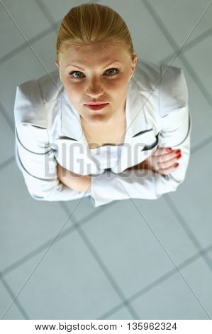 Portrait of a happy young business woman standing