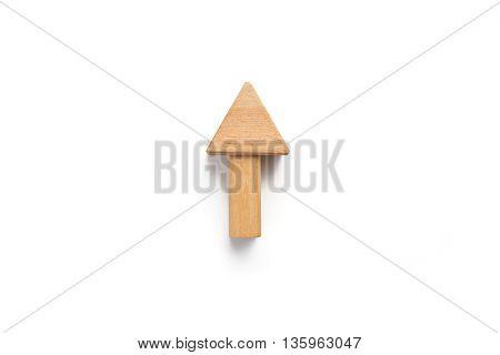 Up arrow isolated on white background. Wood block on white background.