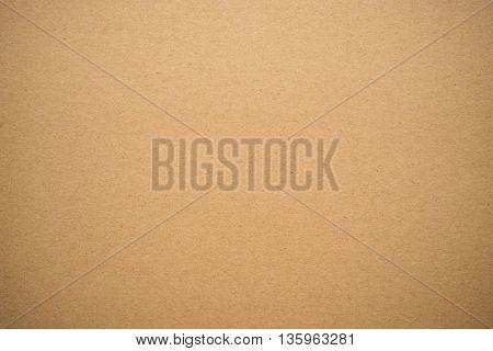 Brown cardboard or paperboard texture background .