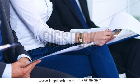 Group of business people sitting on chair in office .