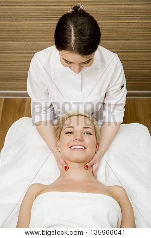 Female in tha spa salon taking a massage