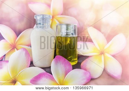 Mini Set Of Bubble Bath And Shower Gel Liquid With Pink Flowers Plumeria Or Frangipani On Timber Or