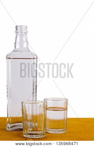 Bottle of Russian vodka and wine glasses on a wooden table