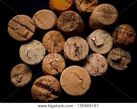 Old bottle cork on a dark background view from above