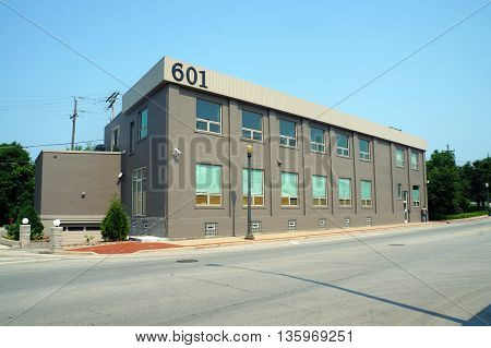 JOLIET, ILLINOIS / UNITED STATES - JUNE 30, 2015: A  vacant commercial building at 601 North Chicago Street in downtown Joliet.