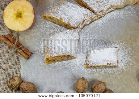 Detail on Sugared Homemade Apple Strudel on a Baking Paper Top View