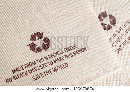 Recycle Sign On Tissue Paper Made From 100% Recycle Fibers, No Bleach Was Used To Make This Napkin,
