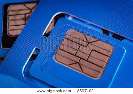 Sim Card Used Of Mobile Smart Phone Close Up Macro Shot On Blue Card Background, Technology Concept