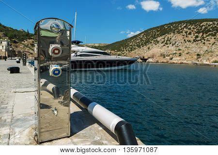 Sevastopol, Russia - June 09, 2016: Column for refueling of yachts and boats at the marina in Balaklava.