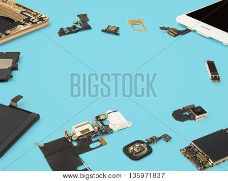 Smart phone components isolate on blue background with copy space