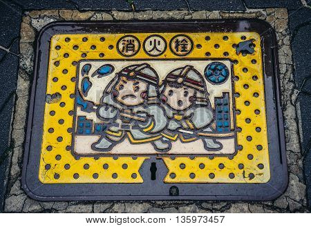 Tokyo Japan - February 26 2015: Close up on cover of ground fire hydrant in Tokyo