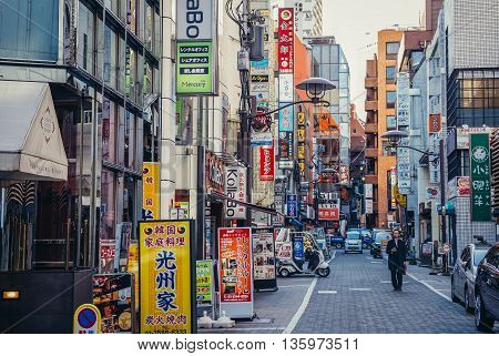 Tokyo Japan - February 27 2015: View on the banners and neon signs on one of the streets in Akasaka district