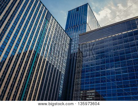 Tokyo Japan - February 27 2015: Modern architecture of Marunouchi dsitrict in Tokyo. View on Marunouchi Trust Towers buildings.