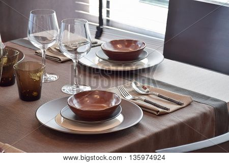 Close up modern classic dining set on wooden dining table