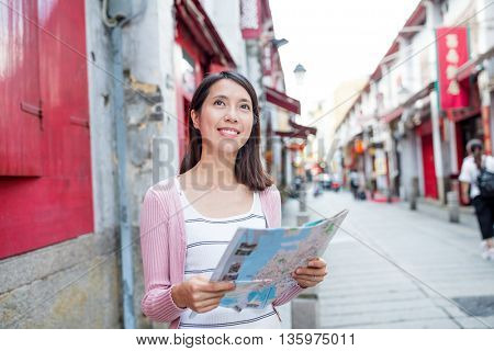 Woman use of city map in Macau