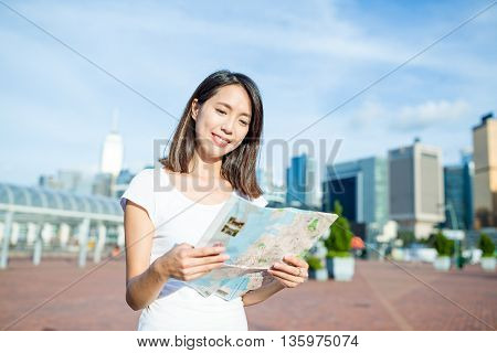 Woman checking on city map