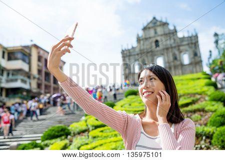 Woman taking selfie in Macau
