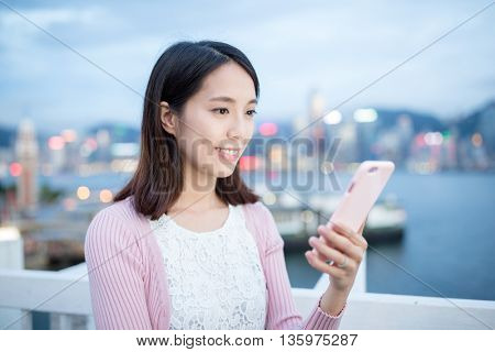 Woman use of cellphone at Hong Kong