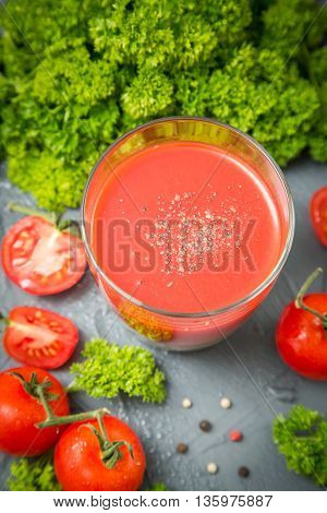 fresh organic tomatoes and tomato juice with parsley. the detox concept