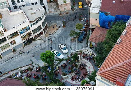 Aerial view of urban cafe and street life as viewed directly above from Galata Tower Istanbul Turkey