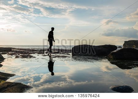 Silhouette, a guy with reflection on the island