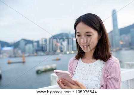 Woman use of mobile phone at Hong Kong