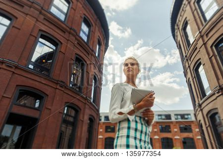 Beautiful girl with a tablet in hands. Toned image. tilt-shift effect