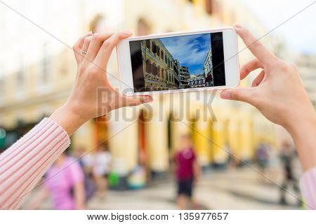 Woman taking photo in Senado Square of Macao