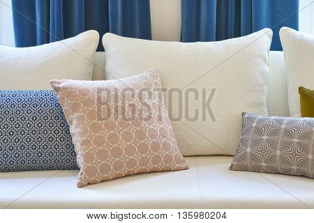 White sofa with cushions and blue curtains. Decoration interior. Horizontal