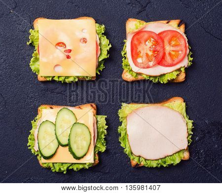 Preparation clubsandwiches on a stone chopping board