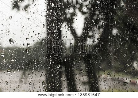 Loneliness through the rain at window ...
