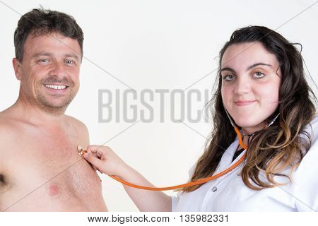 Doctor Woman Auscultating Patient By Stethoscope Isolated On A White