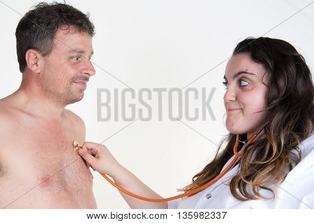 Doctor Female Auscultating Patient By Stethoscope Isolated On A White