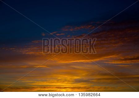 Fiery orange sunset sky. Beautiful sky. Bright orange and yellow colors sunset sky.