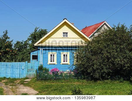 Small country wooden house summer sunny day