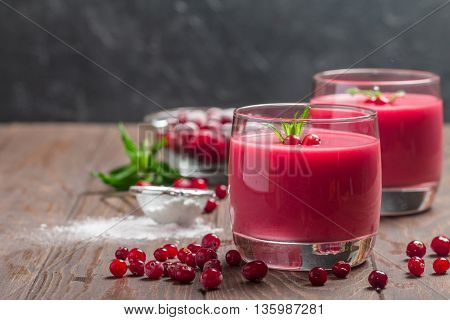 cranberry mousse with semolina on dark wooden background