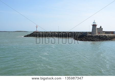 Small Port On Howth Peninsula In Ireland With Lighthouse