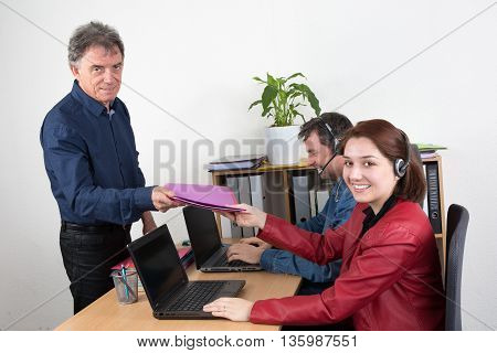 Manager Smiling Male Helping Call Center Gives Folder