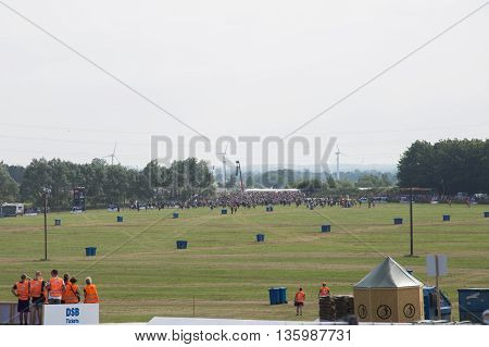 Roskilde, Denmark - June 25, 2016: Crowd of people running to find a campspot at Roskilde Festival 2016.