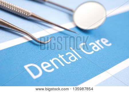 Dental tools, dentist and dental care concept