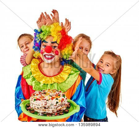 Clown holding cake on birthday with group children. Isolated.