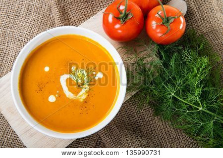 Tomato squash soup with dill and sour cream