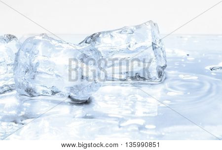 Melted ice cubes on the table