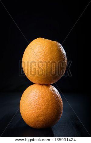 Stack of two juicy oranges