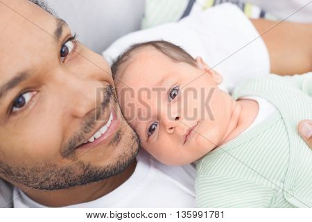 Close up of father and child spending time together